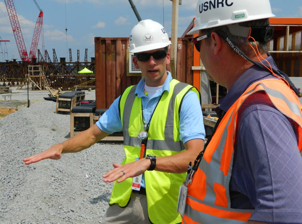 Special Inspector having discussion on construction site
